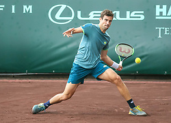 April 13, 2018 - Houston, Texas, U.S. - GUIDO PELLA of Argentina hits the return in the match against T. Sandgren of the United States during the Quarterfinal round of the Men's Clay Court Championship on April 13, 2018 at River Oaks Country Club. (Credit Image: © Leslie Plaza Johnson/Icon SMI via ZUMA Press)
