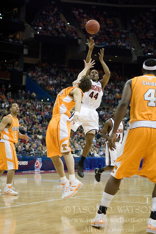 Virginia Cavaliers point guard Sean Singletary (44) shoots over Tennessee Volunteers guard Dane Bradshaw (23).  The #4 seed Virginia Cavaliers were defeated by the #5 seed Tennessee Volunteers 77-74 in the second round of the Men's NCAA Tournament in Columbus, OH on March 18, 2007.