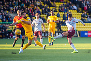 Keaghan Jacobs (#7) of Livingston FC tries to block the shot of Aaron Hickey (#51) of Heart of Midlothian FC during the Ladbrokes Scottish Premiership match between Livingston FC and Heart of Midlothian at the Tony Macaroni Arena, Livingston, Scotland on 26 October 2019.