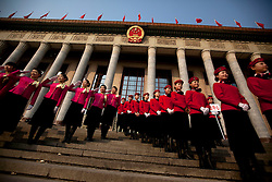 Stewardessed pose for photos during the opening session of the National Peoples Congress (NPC) outside the Great Hall of the People in Beijing, China, on 05 March 2011. The NPC has over 3,000 delegates and is the world's largest parliament or legislative assembly though its function is largely as a formal seal of approval for the policies fixed by the leaders of the Chinese Communist Party.
