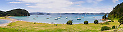 Panoramic eastward view from Motuarohia Island across the Bay of Islands. Sailboats moored.