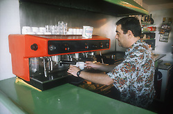 Barman using machine to make coffee,