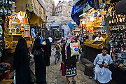 Customers shop at the souk in the old city of Sanaa, Yemen.
