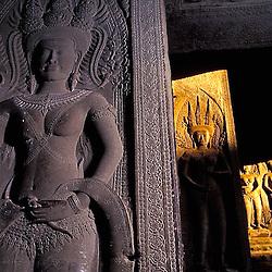 Apsara dancer carvings illuminated by morning sunlight at Angkor Wat, Cambodia.