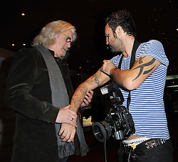 Quartet photocall with Dustin Hoffman, Billy Connolly, Pauline Collins, Sir Tom Courtenay, Sheridan Smith, ahead of tonight's London Film Festival screening of comedy drama about four ageing opera singers. The Empire Cinema, London, United Kingdom..-Billy Connolly, Paul Treadway (photographer), comparing tattoos, October 15, 2012. Photo by Nils Jorgensen / i-Images.