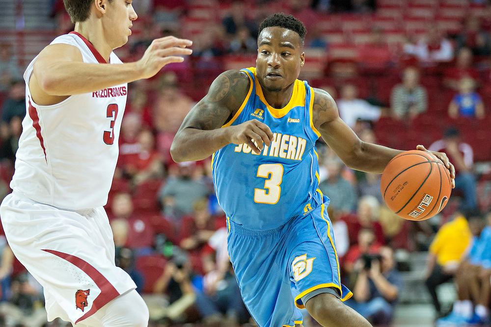 FAYETTEVILLE, AR - NOVEMBER 13:  Treiun Banks #3 of the Southern University Jaguars drives around Dusty Hannahs #3 of the Arkansas Razorbacks at Bud Walton Arena on November 13, 2015 in Fayetteville, Arkansas.  The Razorbacks defeated the Jaguars 86-68.  (Photo by Wesley Hitt/Getty Images) *** Local Caption *** Treiun Banks; Dusty Hannahs