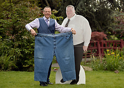 Stuart Eggleshaw from Kirkby-in-Ashfield poses with his old trousers and a photograph of him before the weight loss, as he is announced as Slimming World Greatest Loser 2014 after losing 22st 9lbs at Kensington Roof Gardens, London.
