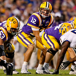 October 16, 2010; Baton Rouge, LA, USA; LSU Tigers quarterback Jarrett Lee (12) under center during the first half against the McNeese State Cowboys at Tiger Stadium.  Mandatory Credit: Derick E. Hingle