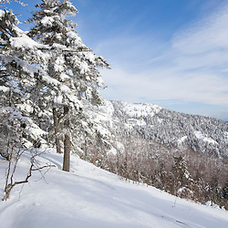 PJ Ledge after a fresh snowfall  on Mount Cardigan in Canaan, NH.  Clark Trail.