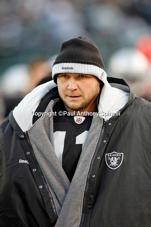 Oakland Raiders kicker Sebastian Janikowski (11) looks on while wearing a coat and hat on a cold day during the NFL week 15 football game against the Detroit Lions on Sunday, December 18, 2011 in Oakland, California. The Lions won the game 28-27. ©Paul Anthony Spinelli
