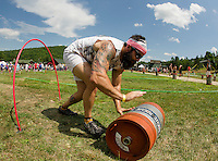 "Mr. Brimbles (Tony Hersey) of the""We're Not Cat Drunk"" team scambles through the ""Keg Croquet"" game during the Craft Beer Relay at Gunstock Mountain Resort on Saturday.  (Karen Bobotas/for the Laconia Daily Sun)"