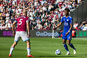 Demarai Gray (Leicester City) with the ball in front of Pablo Zabaleta (West Ham) during the Premier League match between West Ham United and Leicester City at the London Stadium, London, England on 20 April 2019.