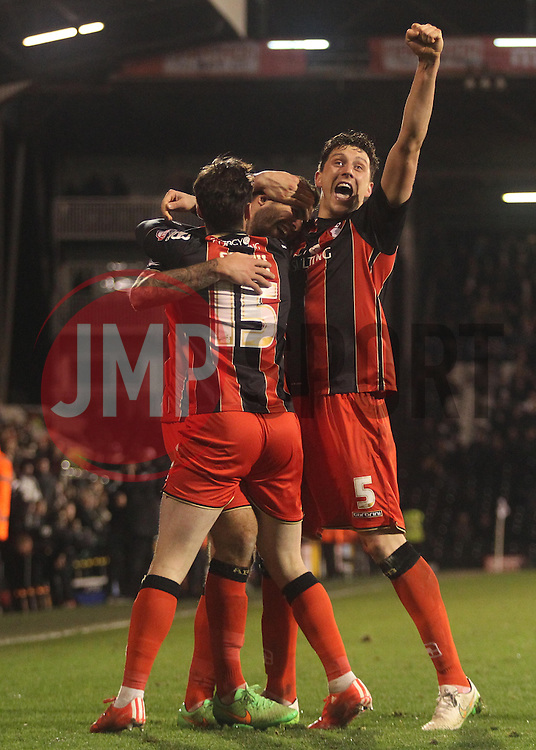 Bournemouth's Steve Cook celebrates with Bournemouth's Adam Smith and Bournemouth's Tommy Elphick after scoring - Photo mandatory by-line: Robbie Stephenson/JMP - Mobile: 07966 386802 - 06/03/2015 - SPORT - Football - Fulham - Craven Cottage - Fulham v AFC Bournemouth - Sky Bet Championship