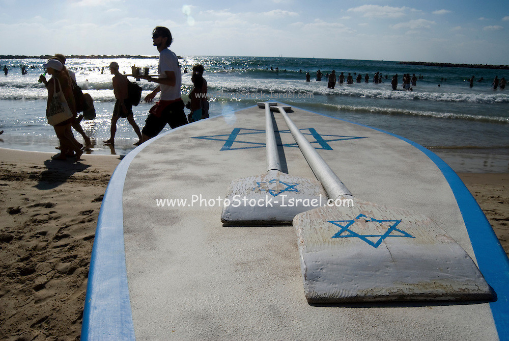 Israel, Tel Aviv, A Hasakeh or flatboard boat used by the lifeguards in case of emergency .
