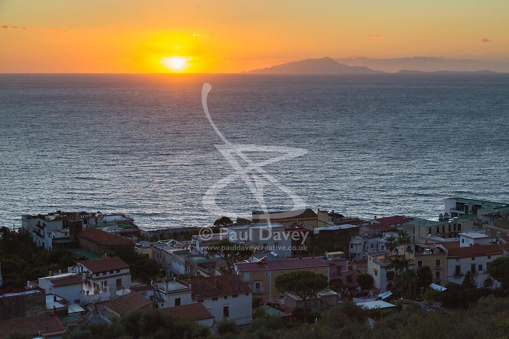 Sorrento, Italy, September 17 2017. The sun sets over the Mediterranean Sea near the island of Ischia across the Bay of Naples from Sorrento, Italy. © Paul Davey