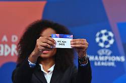 NYON, SWITZERLAND - Monday, December 17, 2018: Lyon player Laura Georges holds up Ajax after making the draw during the UEFA Champions League 2018/19 Round of 16 draw at the UEFA House of European Football. (Handout by UEFA)