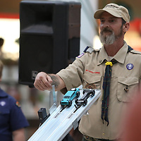 Tiger Den Leader of Pack 9, Greg Neighbors, waits to release the cars for the next run of the Pinewood Derby Saturday at the Mall at Barnes Crossing food court.  Winners of today will advance to the Yocona Area Council Pinewood Derby at the Tupelo Auto Museum next month