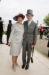 MR DAVID & the HON.MRS SIEFF at the Investec Derby 2013 held at Epsom Racecourse, Epsom, Surrey on 1st June 2013.