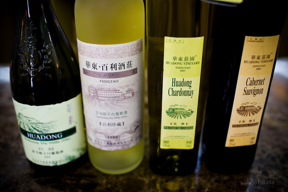 Wine from the Huadong Winery, from left to right: chardonnay 2004,  chardonnay 1998, chardonnay 2003, cabernet sauvignon, 2003, are seen in Qingtao, China, June 23, 2009.