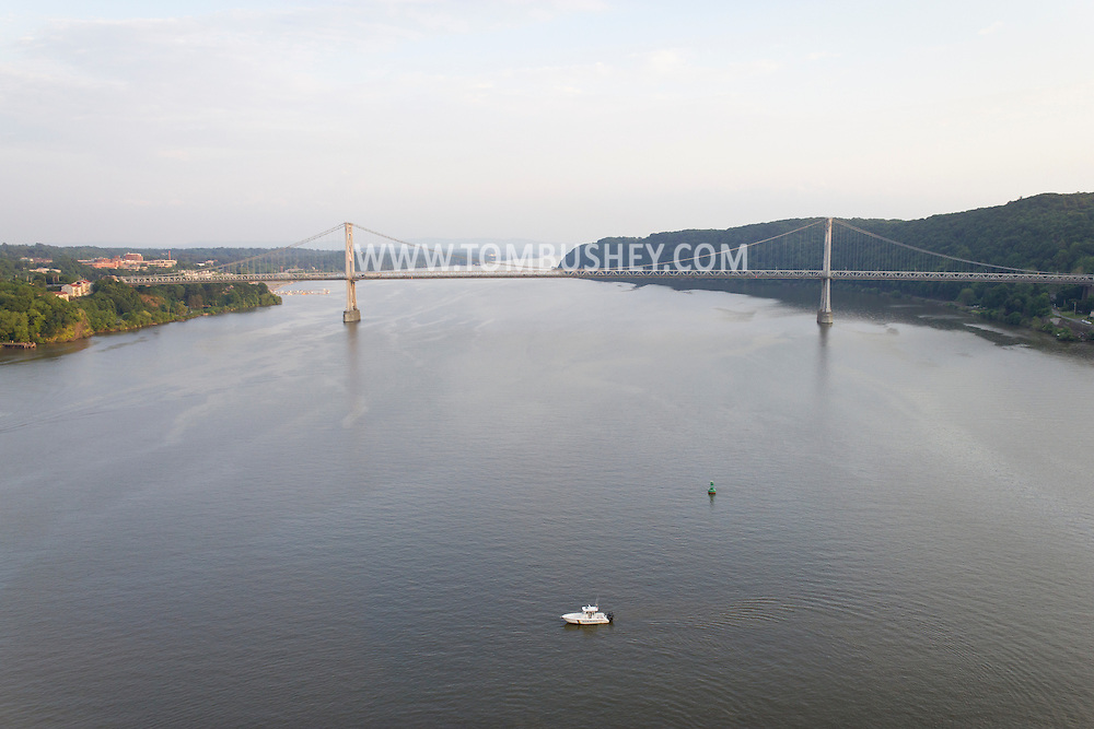 Highland, New York - A view of a boat in the Hudson River with the Mid-Hudson Bridge in the background seen from the Walkway over the Hudson on May 27, 2012.