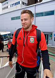 CARDIFF, WALES - Saturday, June 10, 2017: Wales' Chris Gunter boards the team plane as the squad depart Cardiff Tesla Airport to travel to Belgrade ahead of the 2018 FIFA World Cup Qualifying Group D match against Serbia. (Pic by David Rawcliffe/Propaganda)