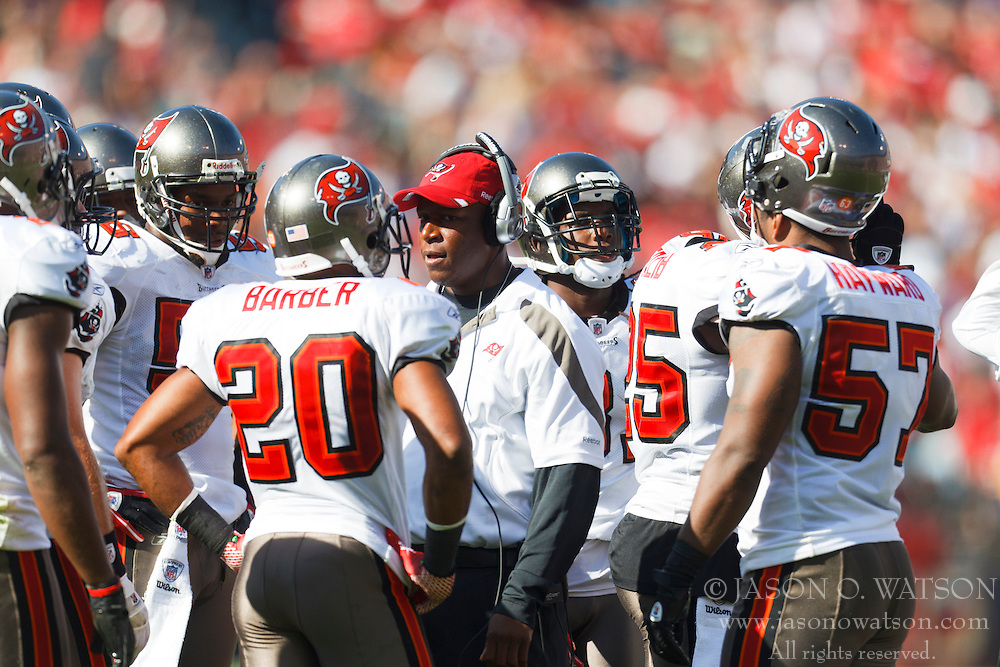 Oct 9, 2011; San Francisco, CA, USA; Tampa Bay Buccaneers head coach Raheem Morris (center) talks to his team during a time out against the San Francisco 49ers during the third quarter at Candlestick Park. San Francisco defeated Tampa Bay 48-3. Mandatory Credit: Jason O. Watson-US PRESSWIRE