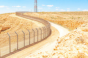Route 10 along the Egyptian - Israeli border. Looking into Egypt from Israel The touch activated fence placed to prevent African refugees from entering Israel