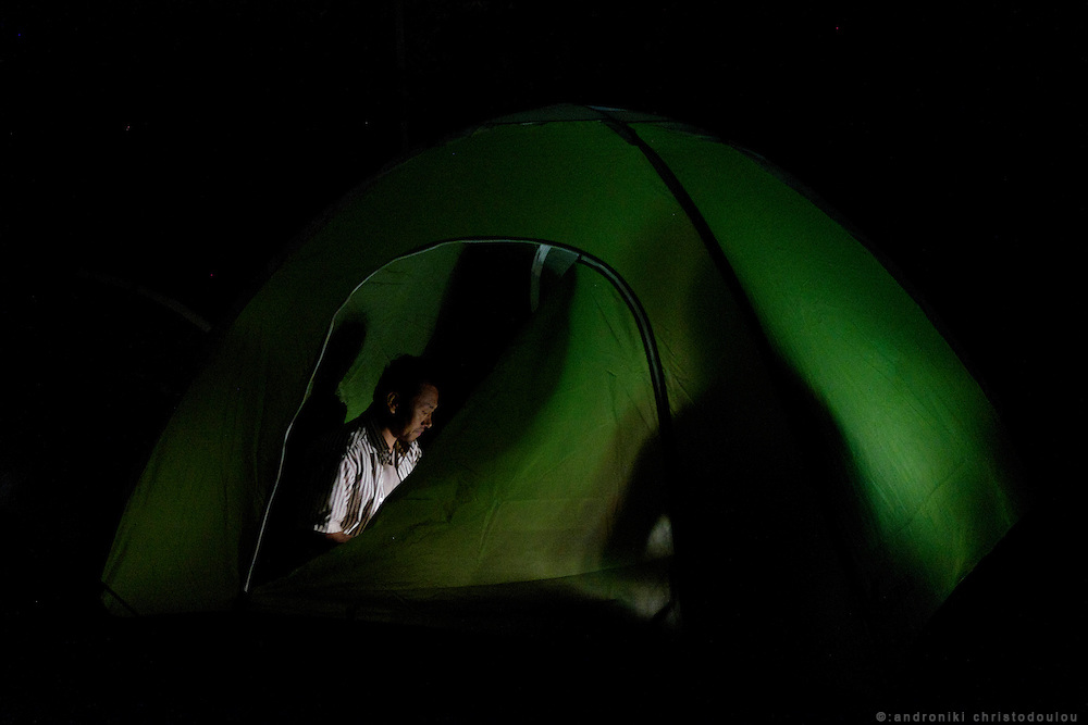 Man inside his tent.<br /> Moria refugee camp is a bit further out of Mytilene city and it is divided in two sections. The inner part is well organised with buildings and police guarding it, and the outer part where mainly Afghan refugees live in tents and is purely guarded with chaotic situations, mainly during food distribution, frequently occur.