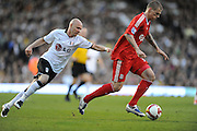 Martin Skrtel (Liverpool) gets away from Andy Johnson (Fulham). Fulham v Liverpool, Barclays Premier League,  Craven Cottage,  London. 4th April 2009.