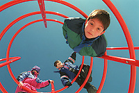WINCHESTER- Ryan Williamson hangs upside down from a new jungle gym at the Vinson-Owen playground as Nick and Casey Schaejbe climb up top.  Boston Globe Photo by Bethany Versoy. RESTRICTED USE..NOT FOR REPBULICATION WITHOUT EXPLICIT APPROVAL FROM DIRECTOR OF PHOTOGRAPHY..