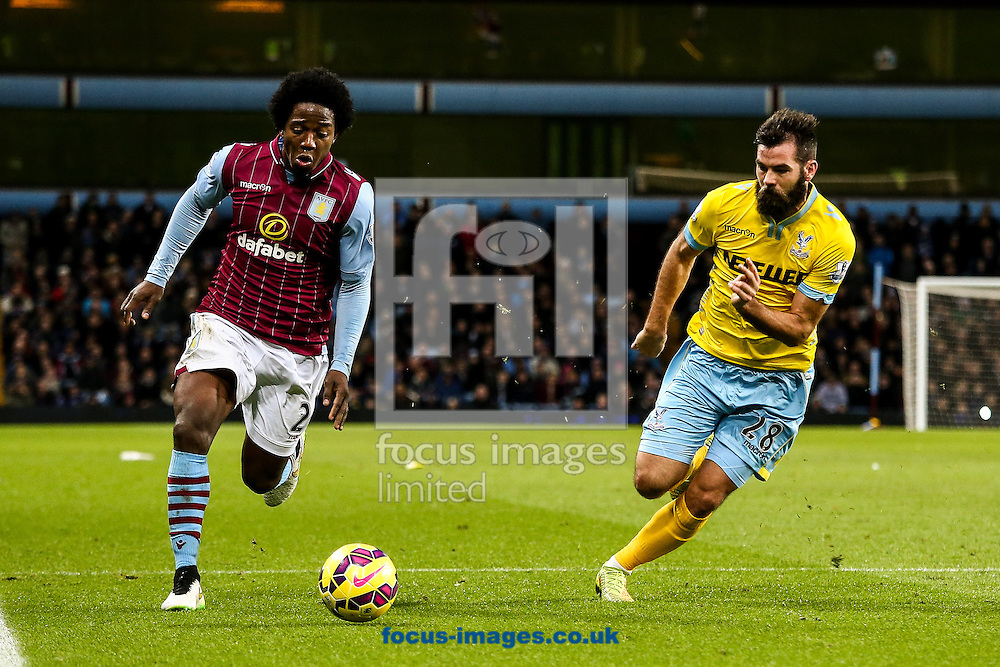 Carlos Sanchez of Aston Villa (left) competing with Joe Ledley of Crystal Palace (right) during the Barclays Premier League match at Villa Park, Birmingham<br /> Picture by Andy Kearns/Focus Images Ltd 0781 864 4264<br /> 01/01/2015