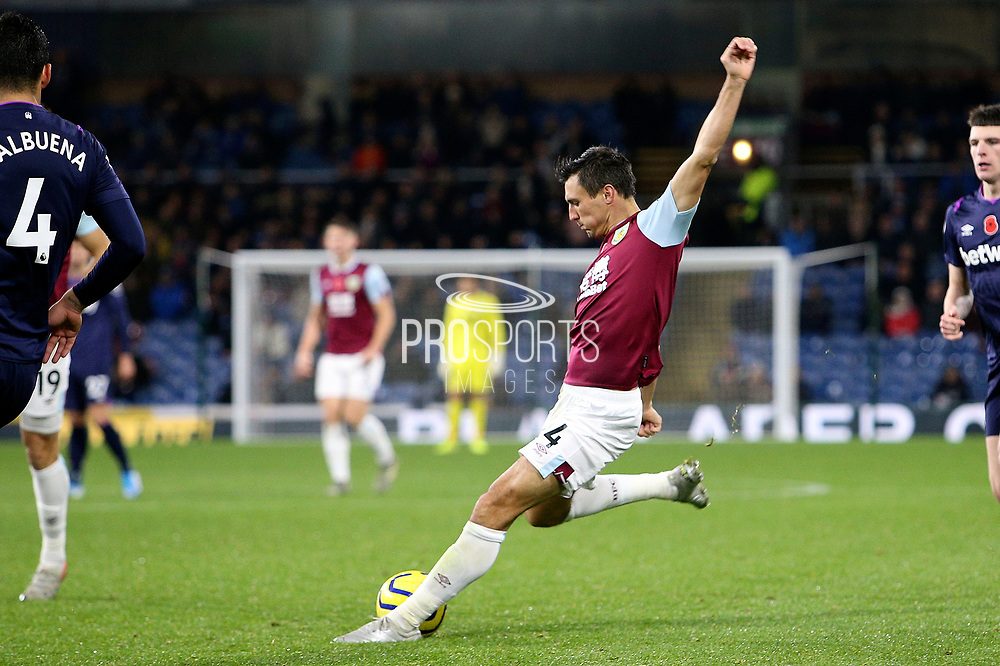 Burnley midfielder Jack Cork (4) shoots at goal during the Premier League match between Burnley and West Ham United at Turf Moor, Burnley, England on 9 November 2019.