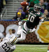 Baylor's Robert Griffin III (10) is tackled before he can get a pass off by Washington's Josh Shirley during game action of the 2011 Valero Alamo Bowl at the Alamodome in San Antonio, Texas on Thursday, Dec. 29, 2011. Baylor won 67-56.