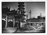 Dating from the 10th century, construction closing in on all sides of Longhua Temple, Shanghai, China.