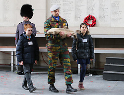 British schoolchildren accompany a bag of soil from the battlefields of flanders at a ceremony on Armistice Day to mark the gathering of soil for the Flanders Fields Memorial Garden at the Guards Museum in London, Monday, 11th November 2013. Picture by Stephen Lock / i-Images