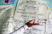 Bhawani Regmi (grey/pink), 16, speaks of child marriage, family planning and pregnancy health at the Kishuri Sachetana Child Club in their activity center in Thahuri Tole, Chhinchu, Surkhet district, Western Nepal, on 1st July 2012. Bhawani's ambition is to be a doctor. 16-year-old Bhawani Regmi (in grey/pink) who is the president of the district level child forum, 11-year-old  Sarawati Regmi (in white), and 10-year-old Ganga Regmi (in pink) are daughters of pandit (Hindu priest) Dharma Raj Regmi who is one of the 3 priests who have agreed to stop solemnizing child marriages. These Child Clubs, supported by the government, Save the Children and their local partner NGO Safer Society, advocate for child rights and against child marriages and use peer support and education to end child marriages and raise awareness. Photo by Suzanne Lee for Save The Children UK