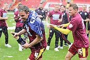 Burnley defender, Michael Duff (04) getting sprayed with champagne by Burnley midfielder, Matthew Taylor (15) during the Sky Bet Championship match between Charlton Athletic and Burnley at The Valley, London, England on 7 May 2016. Photo by Matthew Redman.