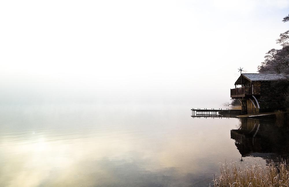 Winter mist on Ullswater at Pooley Bridge boat house, Ullswater, Lake District, Cumbria, England, UK
