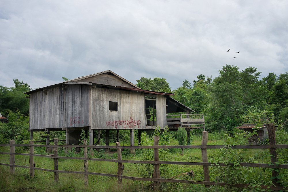 August 25, 2015 - Srekor village, Stung Treng (Cambodia). An abandoned house in a village set to be flooded by the Lower Sesan II Dam. The 400-MW dam—a joint venture between Cambodian businessman Kith Meng and China's Hydrolancang International Energy Co. Ltd.—is set to displace more than 5,000 villagers in Sesan district. Studies claim that the dam could seriously affect fisheries, and in turn the livelihoods of more than 100,000 residents living upstream and downstream of the dam. © Thomas Cristofoletti / Ruom