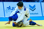 Warsaw, Poland - 2017 April 20: Evelyne Tschopp from Switzerland (white) competes with Odette Giuffrida from Italy (blue) while in the women&rsquo;s 52kg bronze medal fight during European Judo Championships 2017 at Torwar Hall on April 20, 2017 in Warsaw, Poland.<br /> <br /> Mandatory credit:<br /> Photo by &copy; Adam Nurkiewicz / Mediasport<br /> <br /> Adam Nurkiewicz declares that he has no rights to the image of people at the photographs of his authorship.<br /> <br /> Picture also available in RAW (NEF) or TIFF format on special request.<br /> <br /> Any editorial, commercial or promotional use requires written permission from the author of image.