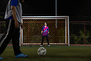 Anticha Sangchai, an openly bi-sexual professor at the Prince of Songklah University Pattani campus, stands in goal on the football pitch where her all-girls club Buku FC practice weekly. She also runs a small book-shop that has books related to gender issues, both of which are not easy in a conservative Muslim area of Southern Thailand that is still in conflict.
