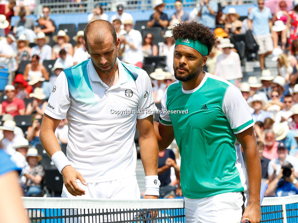 June 21st 2017, Queens Club, West Kensington, London; Aegon Tennis Championships, Day 3; Number five seed Jo-Wilfried Tsonga (FRA) congratulates Gilles Muller (LUX) after their second round match; Muller won in straight sets