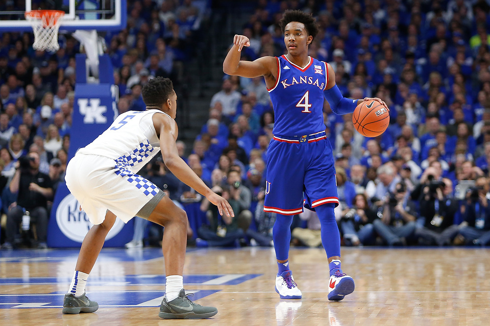 Kansas Jayhawks guard Devonte' Graham dribbles up court against Kentucky Wildcats guard Malik Monk on Saturday January 28, 2017 at Rupp Arena in Lexington, Ky. Photo by Michael Reaves | Staff