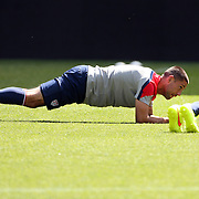 Team Captain Clint Dempsey stretching during the New York Red Bulls Vs Portland Timbers, Major League Soccer regular season match at Red Bull Arena, Harrison, New Jersey. USA. 24th May 2014. Photo Tim Clayton