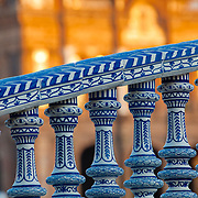An image of an intricate hand painted tile hand rail at the Plaza de Espana. Seville, Spain.