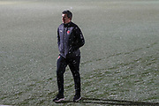 Fleetwood Town manager Joey Barton in the snow during the EFL Sky Bet League 1 match between AFC Wimbledon and Fleetwood Town at the Cherry Red Records Stadium, Kingston, England on 22 January 2019.