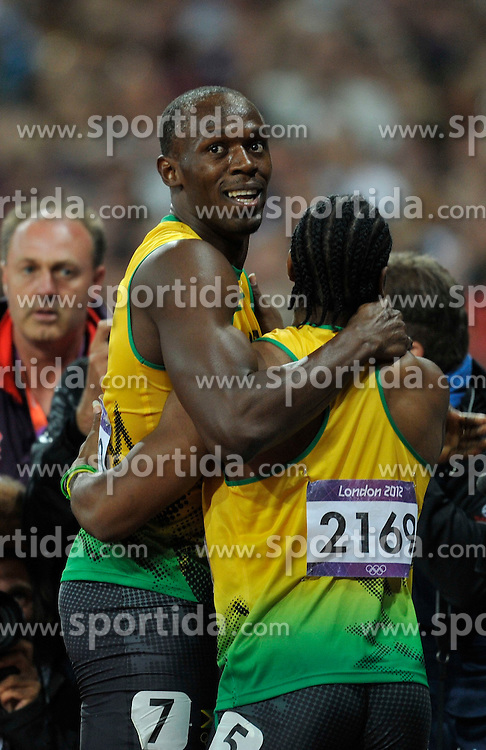 Usain Bolt (JAM) wins the 100m final to take gold for the second time. Celebrates with second place Yohan Blake(JAM). *** Local Caption *** © pixathlon