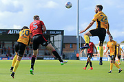 Mickey Demetriou of Newport County outjumps Steven Old of Morecambe at a corner kick during the EFL Sky Bet League 2 match between Morecambe and Newport County at the Globe Arena, Morecambe, England on 16 September 2017. Photo by Mick Haynes.