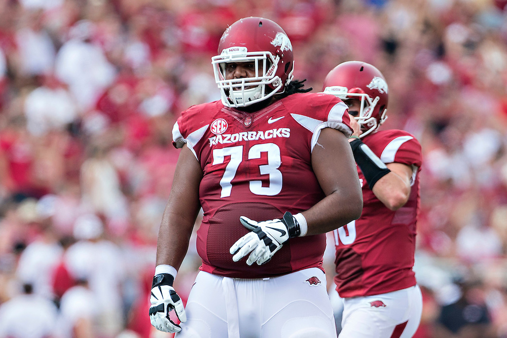 FAYETTEVILLE, AR - SEPTEMBER 5:  Sebastian Tretola #73 of the Arkansas Razorbacks at the line of scrimmage during a game against the UTEP Miners at Razorback Stadium on September 5, 2015 in Fayetteville, Arkansas.  The Razorbacks defeated the Miners 48-13.  (Photo by Wesley Hitt/Getty Images) *** Local Caption *** Sebastian Tretola