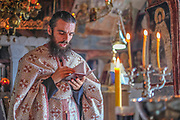 A Serbian Orthodox monk reads bible verses during afternoon liturgy at Zavala Monastery, Zavala Village, Herzegovina.